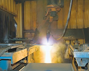 Nassco cuts the first steel part for the USNS William McLean in 2009. Nassco is building 14 T-AKE ships and plans to deliver the last one late next year.