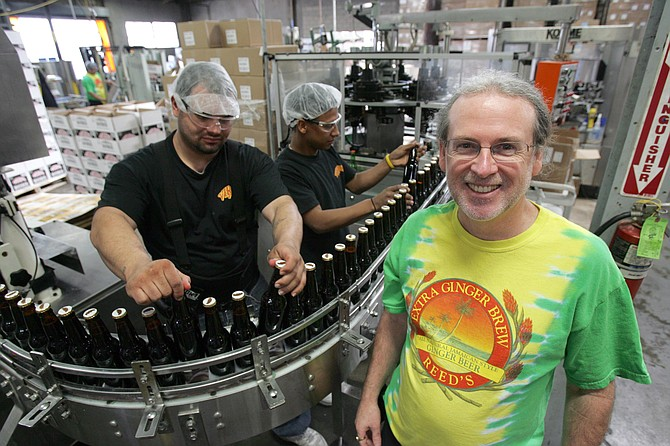 At right, Chris Reed, Reed's founder and chief exec, at the beverage company's facility in Los Angeles.