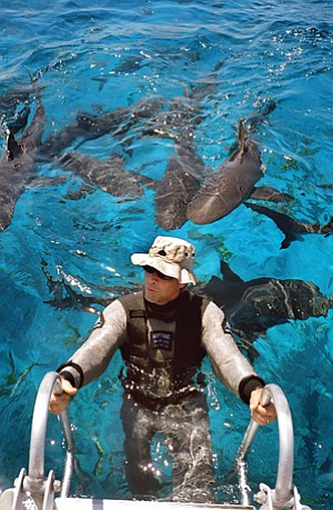 Jeremiah Sullivan, founder of Neptunic Technologies, came up with an idea for a shark suit in the late 1970s. That idea has helped the company secure military and commercial contracts recently.
