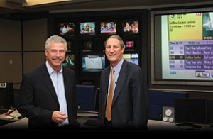 Bill Geppert, left, and David Bialis spend some time in Cox's Communications Center. Bialis succeeds Geppert as Cox's top San Diego executive March 1.