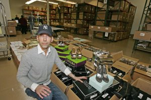 Noah Soltes with shoes at Modnique's warehouse near Playa Vista.