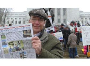 Former OCer Tim Cooley, with his OCBJ, at the protests in Madison, Wis.