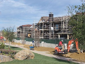 Construction continues on homes and Del Sur's Kristen Glen neighborhood park. The county's housing market is starting to recover.