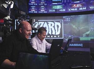 Pearce, Morhaime: cofounders playing Blizzard game at Nasdaq