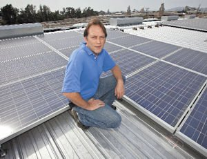 Solar Driven: Kenny Zaucha Jr. with the solar panels that will begin generating electricity at KenWalt Die Casting this month.