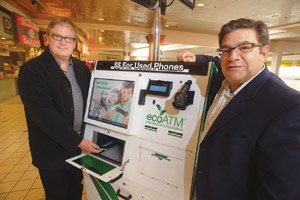 Mark Bowles, left, and Tom Tullie plan to increase the number of ecoATM cell phone-recycling kiosks to 100 this year and 1,000 by the end of 2012.