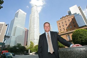 Partner Chris Stouder stands outside Haight Brown's new home at 555 S. Flower St. with U.S. Bank Tower in background.