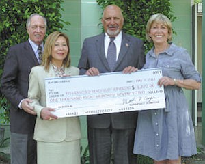 """Martin Cooper (far left) donated the 2010 profits from his book """"North of Mulholland"""" to New Horizons and the Boys & Girls Club of the West Valley. New Horizons CEO Cynthia Kawa (left) and Boys & Girls Club President and CEO Jan Sobel (far right) accepted the check. All future proceeds from book sales will be donated to the organizations. Councilman Dennis Zine attended the presentation."""