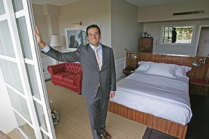 Bob Ghassemieh in one of the new luxury rooms at the renovated Mister C Beverly Hills hotel in Los Angeles on Pico Boulevard.