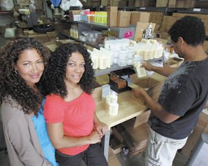 Solution: Wendi Levy (left) and Kim Etheredge started Mixed Chicks out of frustration of having to mix and match products to define and detangle the curls of their hair.