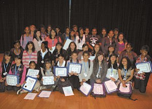 Class: Maclay Middle School students show off certificates for completing health careers program.