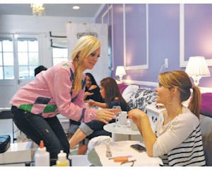 Service: Katie Cazorla (left), owner of The Painted Nail in Sherman Oaks, greets celebrity customer Candace Cameron Bure.