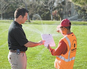Save: Valley Crest employees discuss a water management project.