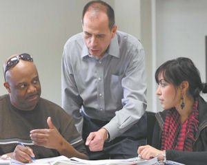 Learning: Dr. Dan Alonzo (center) teaches students in the marriage and family therapy program.