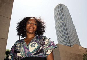 Michele Dennis, president of the Building Owners and Managers Association of Greater Los Angeles among downtown skyscrapers.