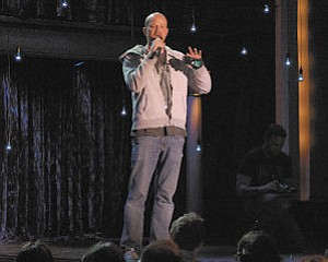 Funny: Brian Volk-Weiss preps the audience for a television special featuring comedian Josh Blue to be released in 2012.