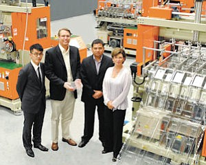 Plastics: Direct Pack executive team with new equipment at Sun Valley facility.