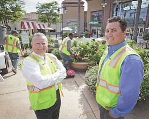 Plants: Stay Green Inc. Founder/Executive Chairman Richard Angelo (left) and President/CEO Chris Angelo (right) oversee a project at Valencia Town Center.
