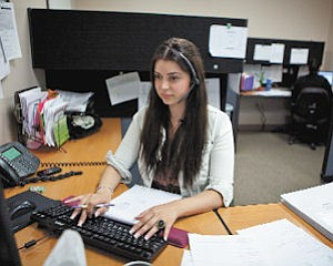 Placement: Idaly Valiente works on scheduling clients at staffing firm Mediscan.