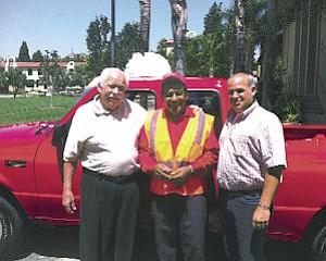 Giveaway: ValleyCrest Gardener Alejandro Lerma Zea (middle) wins truck.