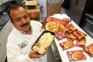 Overhill Executive Chef Salvador Rodriguez with Boston Market item.