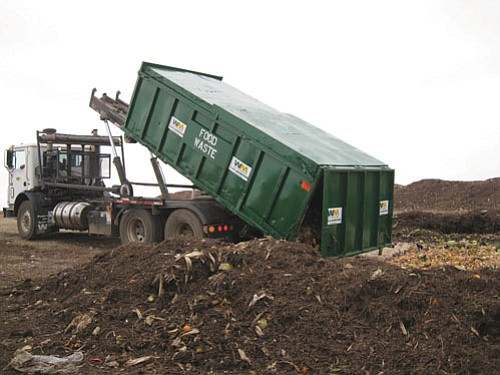 Waste Management Inc. is helping implement a city program to convert food waste from various businesses and organizations into compost.