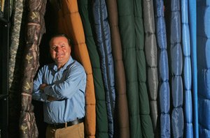Exxel Outdoors CEO Harry Kazazian with some company sleeping bags at headquarters in City of Industry.