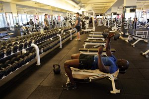 Members lift weights at Equinox's club in Westwood.