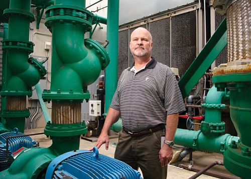 Michael Fredericksen, Gen-Probe's senior director of global facilities, says the company's method of capturing and reusing condensed water from its cooling systems saves energy as well as water.