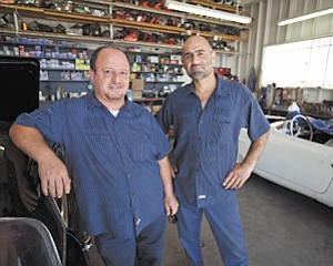 Fix: H.R. Ourichian (left) opened a Northridge auto repair shop with his brother-in-law Reuben Daoulatian.