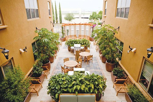 Open courtyards are among featured items at the new 'Granada on Hardy' 50-unit student housing project near San Diego State University.