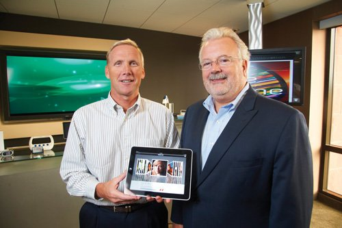 Don Casey, left, and Dr. Joseph Smith of the West Wireless Health Institute show a prototype of a wireless fetal monitor where the data is transmitted to a tablet computer. The institute, Qualcomm Inc. and the Wireless-Life Sciences Alliance have helped put the city on the global map for mobile health.
