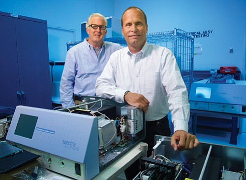 Jim Dorst, left, and Michael Oliver of SpectraScience Inc. are launching the company's first product in Europe, which offers an easier path to market than the United States.