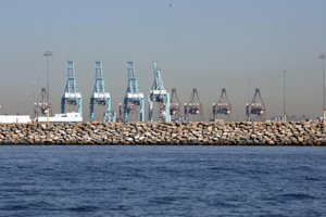 Site of Plains All American's oil terminal at Berth 408 at the Port of Los Angeles with cranes in the background.