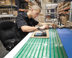 Lights: Corey Garretts applies drivers to LED lights at the Simi Valley factory of Seesmart Inc.