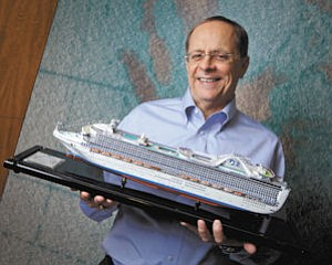 Captain: Alan Buckelew alongside a model of one of Princess Cruises's ships. Helping people fulfill their dream vacation has been personally satisfying, Buckelew said.
