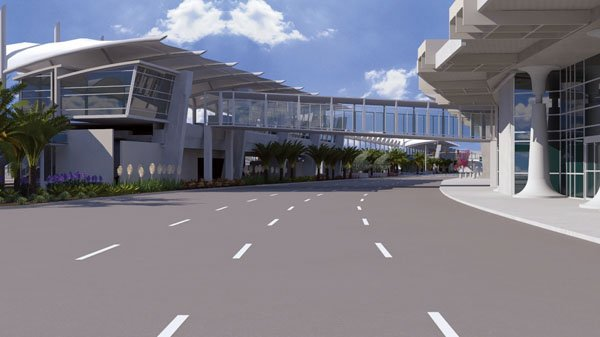 An elevated roadway is being built in front of San Diego International Airport's Terminal 2 to separate arriving and departing passengers.