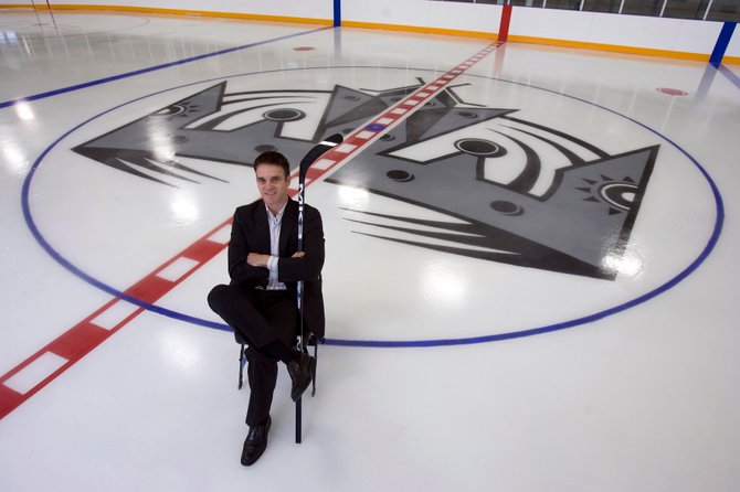 Luc Robitaille, president of business operations for the Los Angeles Kings, sits at center ice at the team's practice facility in El Segundo.