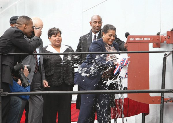 Myrlie Evers-Williams, the widow of civil rights leader Medgar Evers, christens a U.S. Navy ship bearing her late husband's name during ceremonies Nov. 12 at the General Dynamics Nassco shipyard.