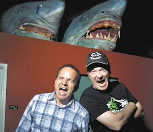 Sharks: Paul Bales (left) and David Latt open wide with props from one of their films.