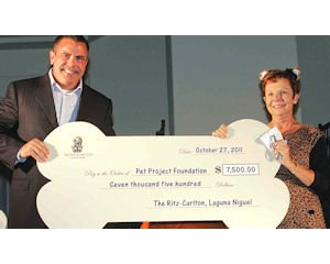 Donation: Ritz-Carlton General Manager Bruce Brainerd presents Pet Project Foundation President Sue Walsh with $7,500