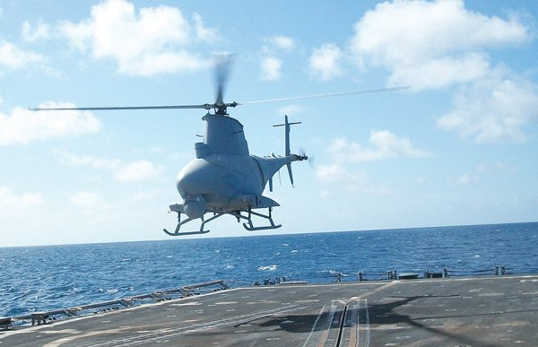 A Fire Scout unmanned helicopter hovers above a U.S. Navy ship in an undated photo. The Navy wants to put weapons on the Fire Scout, and has tapped Northrop Grumman Corp.'s Rancho Bernardo workforce to help it.