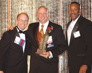 Award: Big Brothers Big Sisters Chairman Erik DiPaolo (left) and Chief Executive Keith Rhodes flank honoree Tim Ryan, executive vice president and chief operating officer of the Anaheim Ducks and chief executive of Anaheim Arena Management LLC