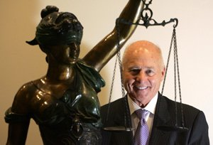 Founding Partner Thomas V. Girardi with a statue of Lady Justice at law firm Girardi Keese's headquarters near downtown Los Angeles.