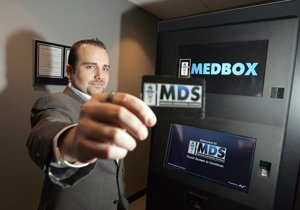 Prescription Vending CEO Vincent Mehdizadeh with MedBox machine and prepaid card.