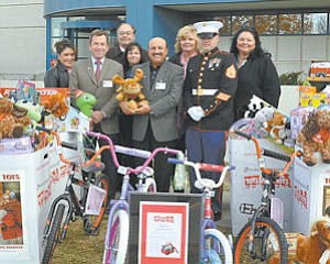 Gifts: Antelope Valley Hospital Staff and a Marine with toys destined for the needy.