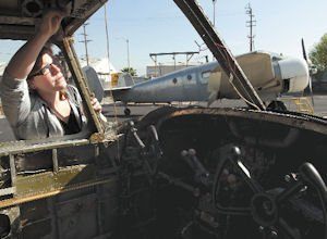 Training: Allison Retig, a student at the North Valley Occupational Center Aviation Center, inspects the cockpit of a Beechcraft D18.