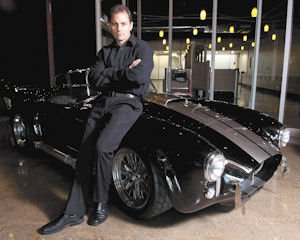 Wheels: The car-related shows made by BCII have their origins in an interest in muscle cars by founder Bud Brutsman, shown here with his 1966 Shelby Cobra 427.