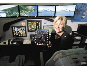 Direction: Liz Iversen in a mock cockpit of an E-2D aircraft in the Rotorcraft Avionics Innovation Lab at Northrop Grumman Navigation Systems in Woodland Hills.