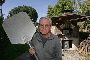 Stambler holds his baking peel in front of the oven in his Los Feliz back yard, where he bakes artisan bread.